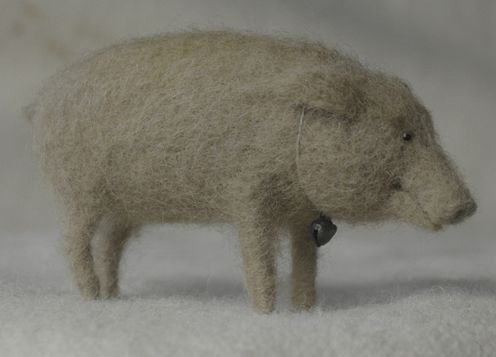 needle felted pig with hair created using a reversed barbs felting needle